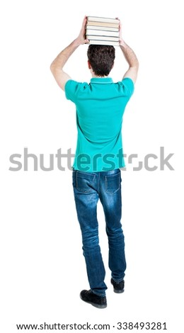 A man carries a heavy pile of books. back view. Rear view people collection.  backside view of person.  Isolated over white background. Man holding a heavy stack of books on his head. - stock photo