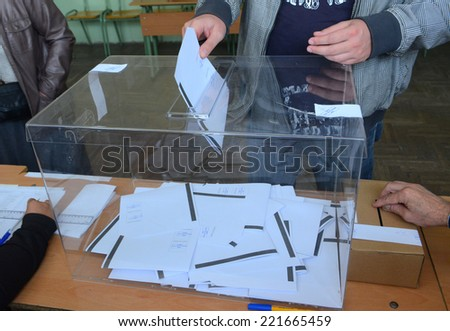 A man casts his vote at a polling station in Sofia October 5, 2014. Bulgaria - stock photo