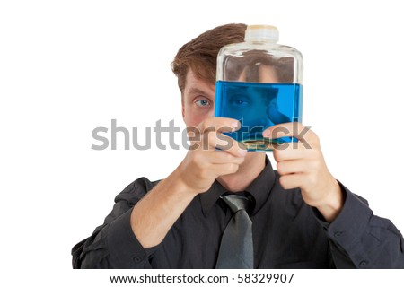A man checks the physical properties of the liquid in the bottle