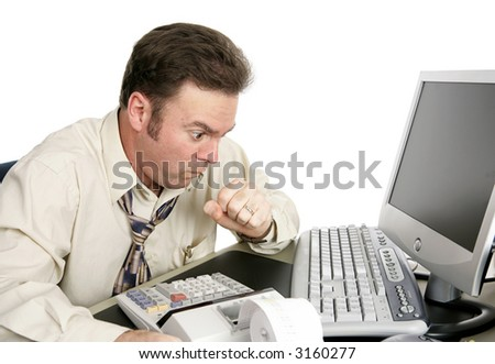 A man choking or coughing while working on the computer.  His eyes are bulging like he's seen something shocking on-line.  Isolated on white.