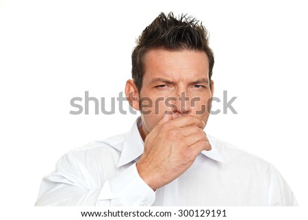 A man coughing into his hand on white background - stock photo