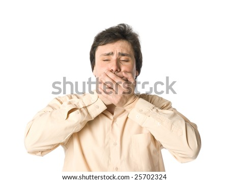 A man covering his mouth with hands - stock photo