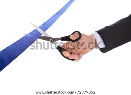 A man cutting a ribbon - stock photo