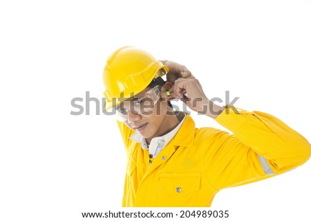 A man demonstrate how to wear ear plug properly - stock photo
