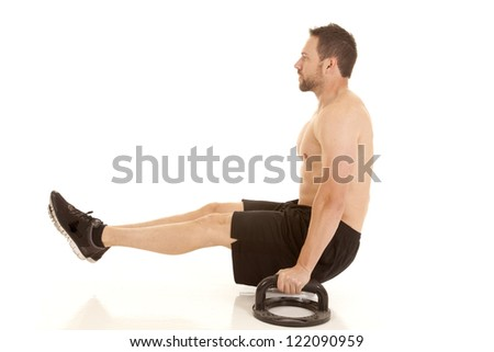 A man doing a different style of push up working out his arms. - stock photo
