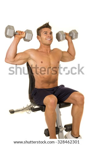 A man doing a shoulder press with weights.
