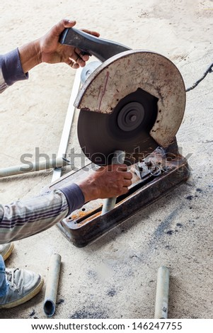 A man doing cut steel. - stock photo