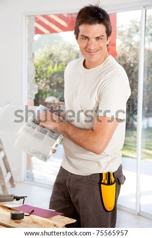 A man doing home improvements in a house