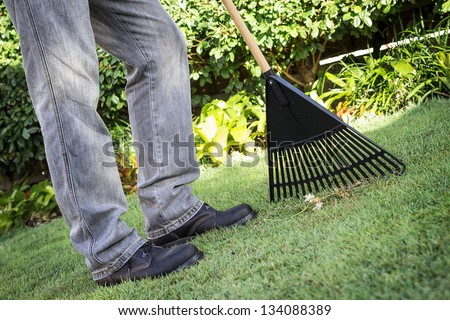 A man doing some garden work - stock photo