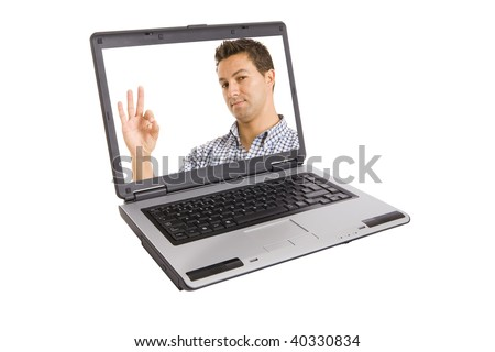 a man doing the sign of ok inside the laptop - stock photo