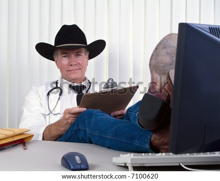 A man dressed in a manner as if to suggest he is a country doctor or a veterinarian. - stock photo
