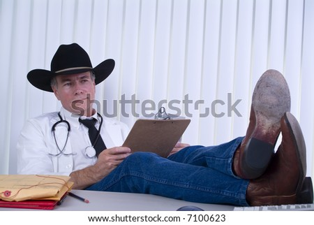 A man dressed in a manner as if to suggest he is a large animal veterinarian, or a country doctor. - stock photo