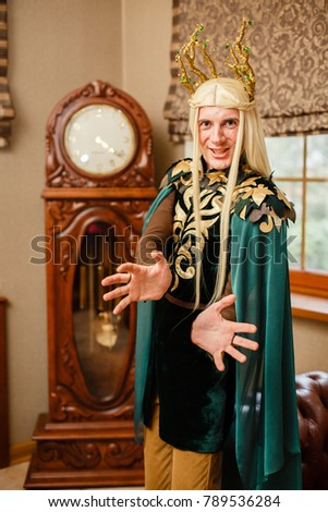 A man dressed in an elf costume. Elf with white hairs in the interior  sc 1 st  Shutterstock & Man Dressed Elf Costume Elf White Stock Photo (Royalty Free ...