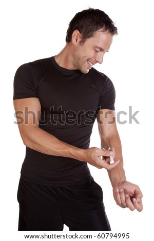 A man dressed in black is giving himself a shot. - stock photo
