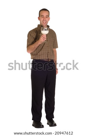 A man drinking some milk out of a wine glass