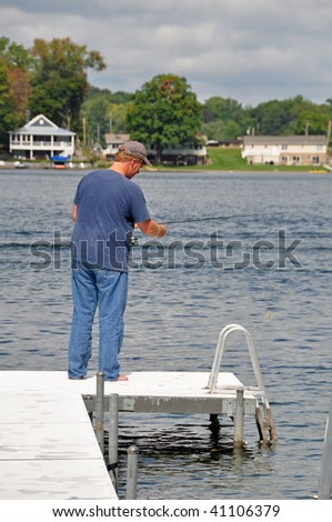 a man enjoys a day fishing - stock photo