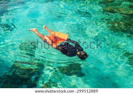 A man enjoys his snorkelling with clear water, Thailand