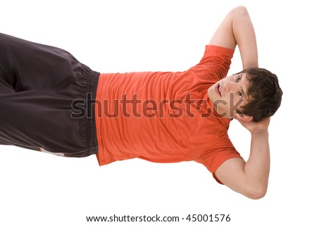 A man exercising by doing crunches trying to get healthy.