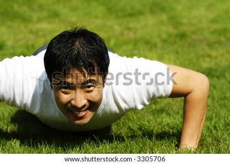 A man exercising by doing push ups