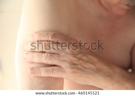 A man experiences soreness in his upper arm.