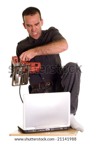 A man experiencing some computer frustrations and is getting even - stock photo