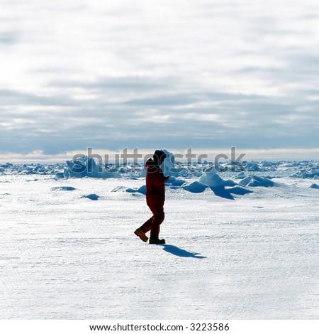 A man exploring Antarctica - stock photo