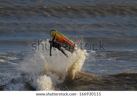 A Man Falling off a Jet Ski in the Sea  - stock photo