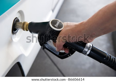A man filling his tank with diesel - stock photo