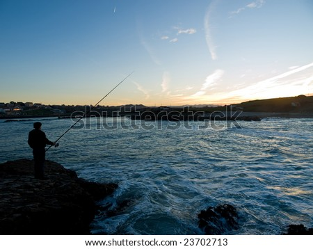A man fishing in Santander, Spain - stock photo