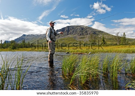 A man fly-fishing in Hemsedal, Norway - stock photo