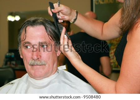 a man gets his monthly hair trim - stock photo