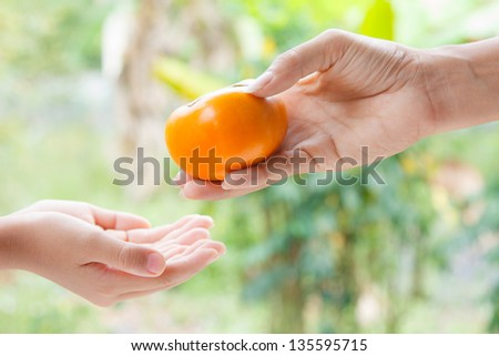 A man give a fruit to other
