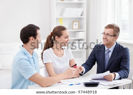 A man gives a credit card consultant - stock photo
