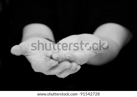 a man gives his hands in asking for help or beg for charity or blessing,  hand palms in black and white