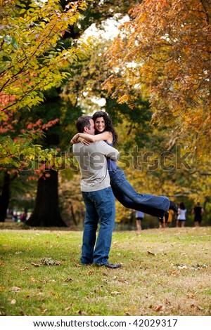A man giving a bear hug to a woman - stock photo
