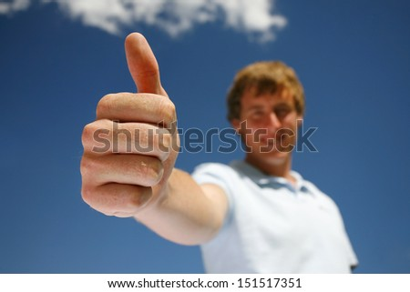 A man giving a thumbs up to show all is well.