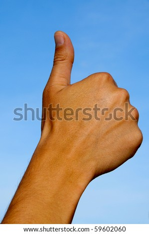 a man hand making the thumbs up sign - stock photo