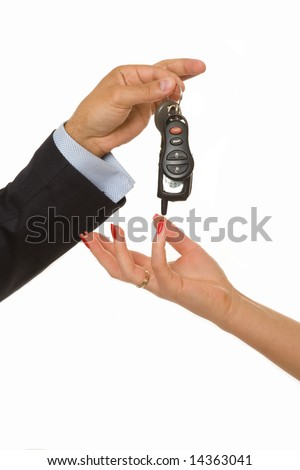 A man hands over a bunch of car keys and car alarm system to a woman