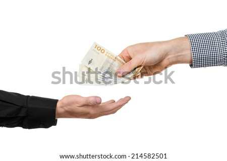 A man hands over danish banknotes to another hand. - stock photo