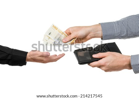 A man hands over 400 danish crowns from a black wallet. - stock photo