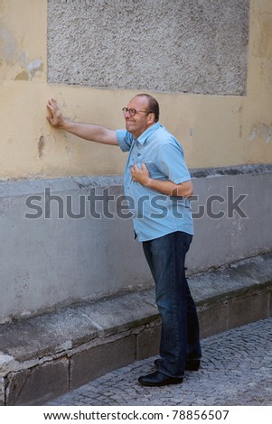 A man has a dizzy spell or a heart attack - stock photo