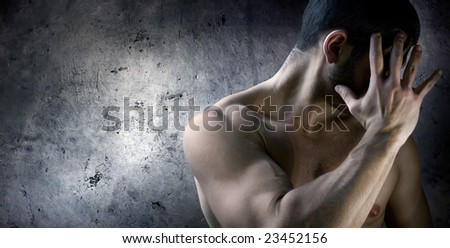 A man hiding his face with his hand showing The concept of the Shame - stock photo