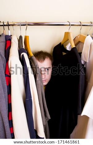 A man hiding in the closet - stock photo