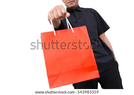 A man hold a red shopping bag(paper bag) on white background, focus bag.