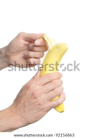 a man holding a banana isolated on white background