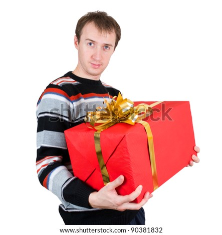 A man holding a big gift isolated on white background - stock photo