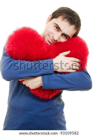 A man holding a big red heart on a white background.