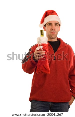 A man holding a bottle of wine, dressed up like one of santas helpers - stock photo