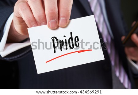 A man holding a Business card Pride Concept