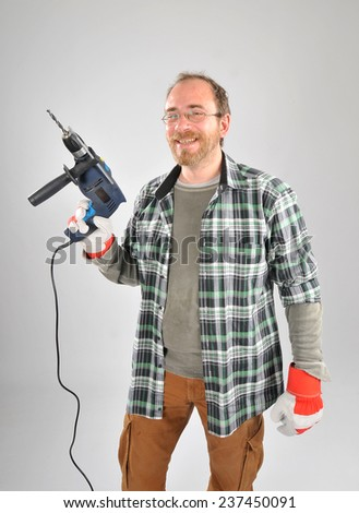 A man holding a drill - stock photo